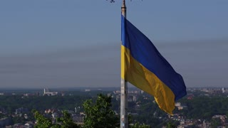 Ukrainian Flag Flying on Top of the Beautiful Panorama of the City Lviv. Aerial Shot in Lviv UltraHD