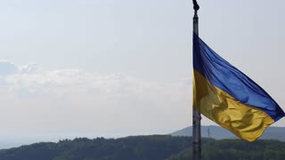Ukrainian Flag Flying on Top of the Beautiful Panorama of the City Lviv. Aerial Shot