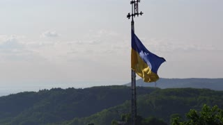 Ukrainian National Flag Flying on Top of the Beautiful Panorama of the City Lviv. Glory to Ukraine. The Heroes of the Glory