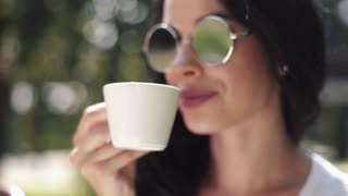 Attractive brunette woman drinking coffee