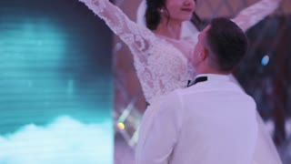 Beautiful Bride and Handsome Groom Dancing First Dance