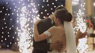 Beautiful young newlyweds dancing their first dance