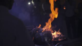 Cooking Meat on Fire
