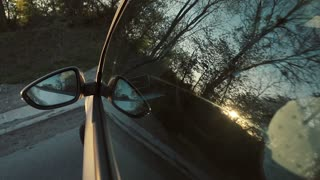 Driving at Sunset through the left window