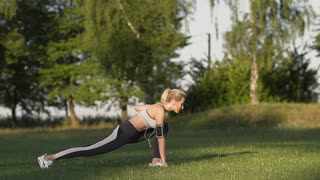 Exercises on the Lawn at Sunny Morning