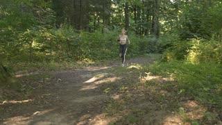 Fitness Girl Runner in Sporty Top Jogging in the Park