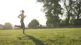 Fitness Girl Runs in the Morning Light