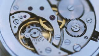 Gears And Mainspring In The Mechanism Of A Watch