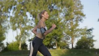 Girl Runs in the Morning Park