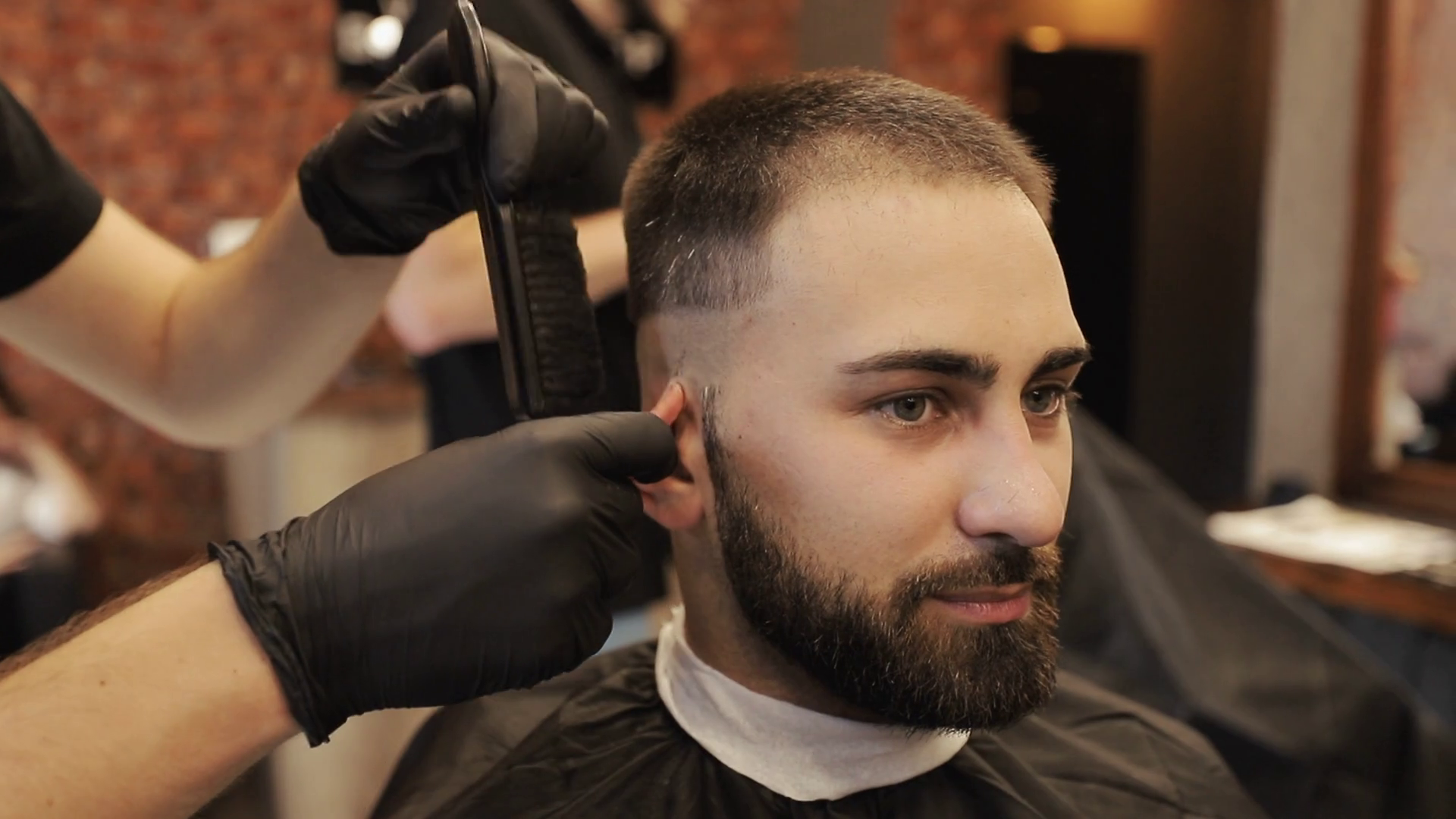 Hairdresser Doing Haircut In Hair Salon Barber Cuts Bearded Man S Hair With A Clipper In Barbershop Men S Hairstyling And Hair Cutting In Salon Stock Video Footage Storyblocks