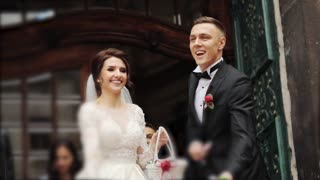 Newlyweds leave the church and sweeps sweets sweetened