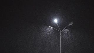 night snowfall near street lamp