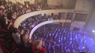 People applauding at a concert