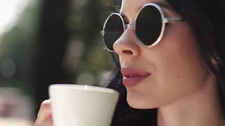 Pretty girl drinking coffee and smiling