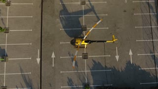 Private yellow helicopter takes off