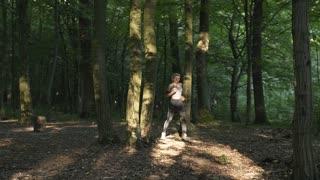 Runner in Morning Woods