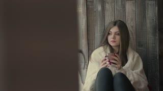 Sad girl near window thinking about something