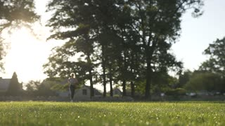 The Girl Running In Summer Park