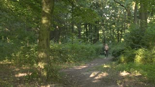 Woman Running on Woods Road
