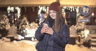 Woman using Mobile Phone of Night Town