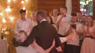 Young beautiful bride and groom dancing first dance at the wedding party. Wedding dance