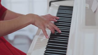 Young Woman Playing Piano