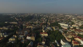 View of the area of the old European town with the town hall. Downstairs you can see how people strolling tourists and city residents. Filmed in Lviv, Ukraine