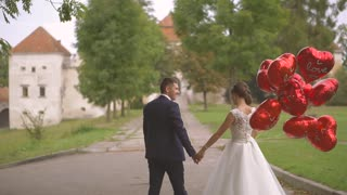Wedding Bride And Groom on the Walk. The Launch Balloons