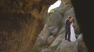 Wedding Bride And Groom Walk in a Rocks. Slow motion