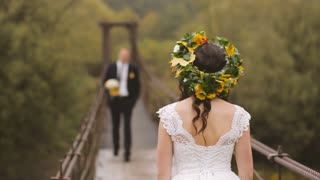 Wedding Bride and Groom Walk on Wooden Bridge. Slow motion