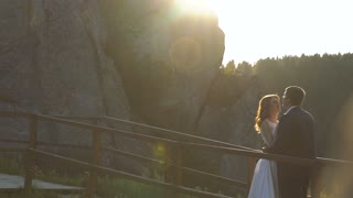Wedding Bride And Groom Walk. Walk on the Rock in Sunset. Slow motion
