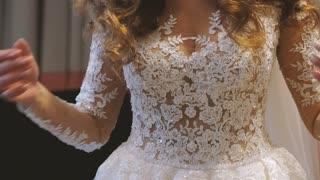 Wedding morning. Lacing Wedding Dress