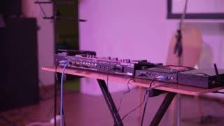 beatboxer adjusts loop station