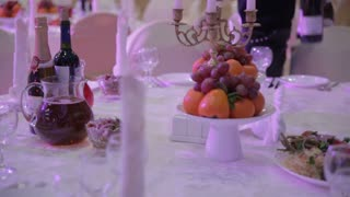 grapes and oranges on a table in the restaurant before a banquet