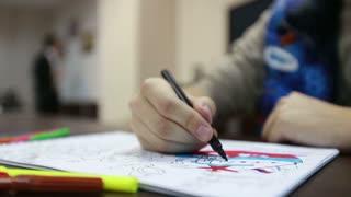 man paints coloring box pages