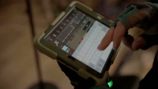 sound engineer with iPad