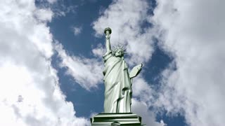 Statue Of Liberty stands on cloud background