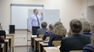 teacher teaches in the classroom