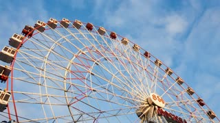Underside view of a ferris wheel over blue sky 4K Moscow