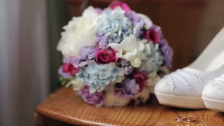 Wedding shoes rings bouquet of flowers