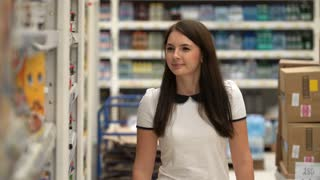 girl buys chocolate paste in a store or supermarket.
