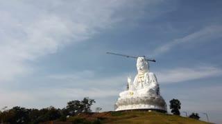 Time Lapse of white big Quan Yin Buddha Statue, wathyuaplakang, Chiang rai, Thailand
