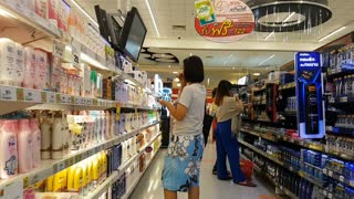 CHIANG RAI, THAILAND - JUNE 3: unidentified asian woman choosing a body lotion in supermarket on June 3, 2018 in Chiang rai, Thailand.