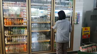 CHIANG RAI, THAILAND SEPTEMBER 26: unidentified asian woman choosing drinking water in 7-Eleven convenience store on September 26, 2018 in Chiang rai, Thailand.