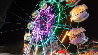 KALASIN, THAILAND - MARCH 2 : Colorful Ferris wheel at night in Pong Lang Festival on March 2, 2018 in Kalasin, Thailand.