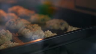 00:02 | 00:13 1×  Cookies on a baking tray in the oven close up, Pan shot