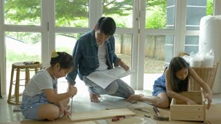 4K : Asian lovely girls helping her father assembling new DIY furniture at home together
