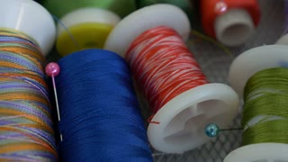 4K : Dolly shot of colorful spools of thread in textile factory, Manufacture industrial textile spinning