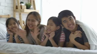 4K : Happy Asian family, Daughter playing with their parents on the bed