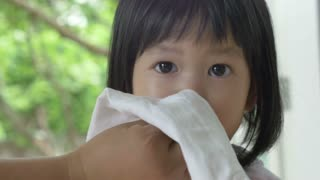 4K : Little Asian child sick with flu sneezing and clean by mother